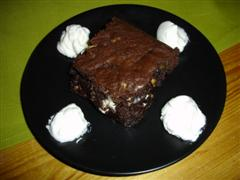 Triple Chocolate and Pecan Brownies with Whipped Cream